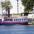 Stock Photo: Red White and Blue Ferry on Blue River