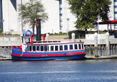 Red White and Blue Ferry on Blue River — Stock Photo
