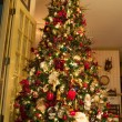 Stock Photo: Santand Gifts Under Decorated Christmas Tree