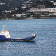 Stock Photo: Blue and White Freighter in Blue Bay