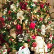Stock Photo: Many Gifts Under Custom Decorated Tree