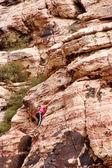 Woman Climbing Canyon Wall — Stock Photo