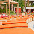 Orange Chaise Lounges at a Resort Patio — Stock Photo #5902227