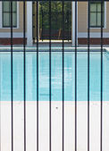 Pool Through Iron Fence — Stock Photo