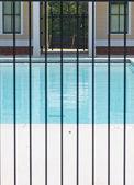 Pool Through Iron Fence — Stock Photo