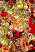 Bold Colored Christmas Decorations on a Tree — Stock Photo