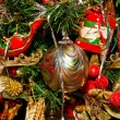 Stock Photo: Striped Gold Ornament on Christmas Tree