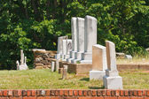 Old Granite Tombstones by a Brick Wall — Stock Photo