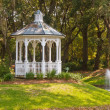 Royalty-Free Stock Photo: White Gazebo on Green Hill by Lake Fountain