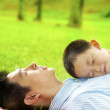 Boy asleep on dad's chest — Stock Photo