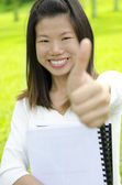 Female student thumbs up with great smile. — Stock Photo