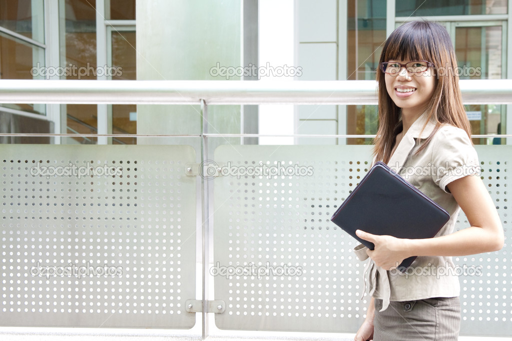 Education / Business woman passing by office building — Stock Photo #5693007
