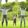 Joyful family jumping together — Stock Photo