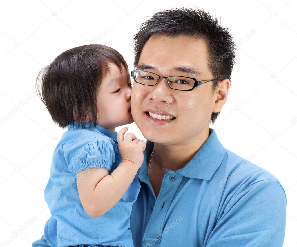 Little girl kissing her father on white background  Stock Photo #5851419