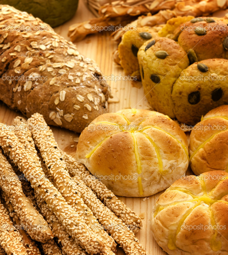 Variety of Organic Breads on plank background — Stock Photo #5851909