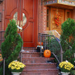 Stock Photo: A grand main entrance of a house with halloween decoration