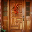 A grand main entrance of a house with halloween decoration - Stock Photo