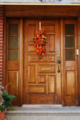 A grand main entrance of a house with halloween decoration — Stock Photo