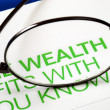 Stock Photo: Focus on growth in wealth isolated on blue