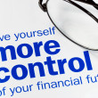 Foto Stock: Focus on and take control of your financial future isolated on blue
