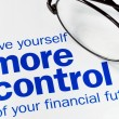 Foto de Stock  : Focus on and take control of your financial future isolated on blue