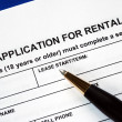 Stock Photo: Signed rental application with pen