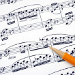 Compose the song on a music sheet with a pencil — Stock Photo