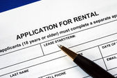 Signed the rental application with a pen — Stock Photo