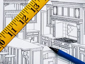 Planificación de una renovación en la cocina con el plano — Foto de Stock
