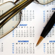 Check out the dates in a business calendar concepts of planning ahead — Photo