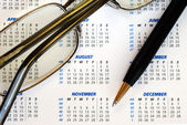 Check out the dates in a business calendar concepts of planning ahead — Stock Photo