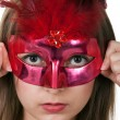 Girl in the red masquerade mask — Stock Photo #5510465