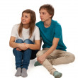 Boy and girl sitting on the floor — Stock Photo