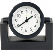 Desktops mechanical clock in a black plastic casing — Stock Photo
