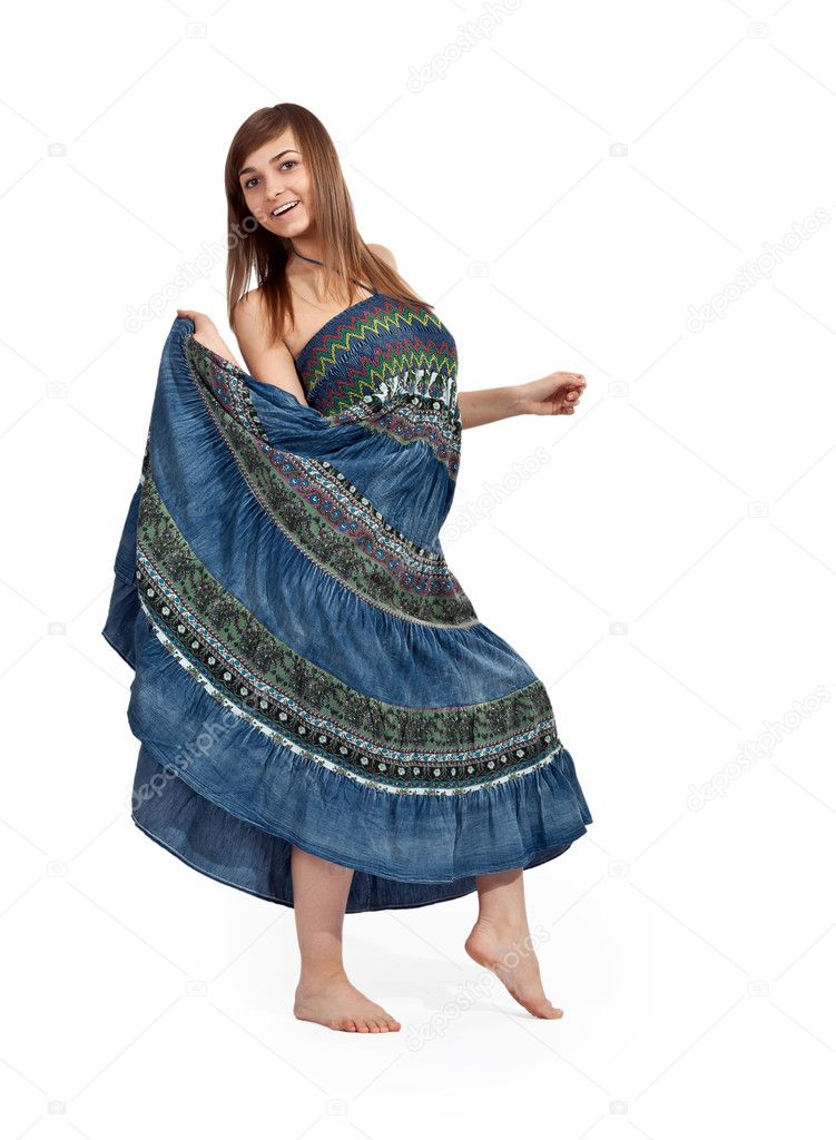 Beautiful girl in jeans sarafan dancing on a light background  Stock Photo #5735240