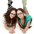 Two sisters lying on a white floor — Stock Photo #5762145