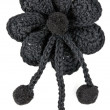 Black knitted fabric flower — Stock Photo