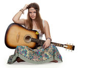 Hippie girl with a guitar — Stock Photo