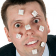 Word STUPID vylodennoe buttons on face — Stock Photo #5999274