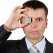 Royalty-Free Stock Photo: Businessman closes one eye, a processor