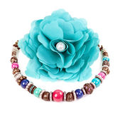 Turquoise fabric flower and color bracelet — Stock Photo