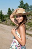 Girl in a straw hat — Stock Photo