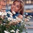 Stock Photo: Portrait of girl with daisies