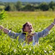 Girl screaming in the grass - Stock Photo