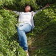 Girl lying in the green grass — Stock Photo