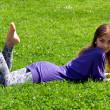 Girl lying on grass — Stock Photo