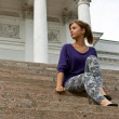 Stock Photo: Beautiful girl sitting on marble steps
