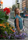Portrait of a girl in a denim vest — Stock Photo