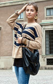 Girl in beige sweater — Stockfoto