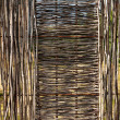 Woven wooden fence - Stock Photo
